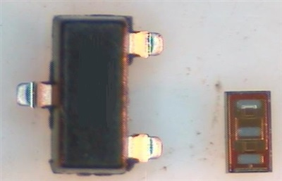 Traditional SOT-23 package next to the CSD18541F5 LGA package. Image Source: TI
